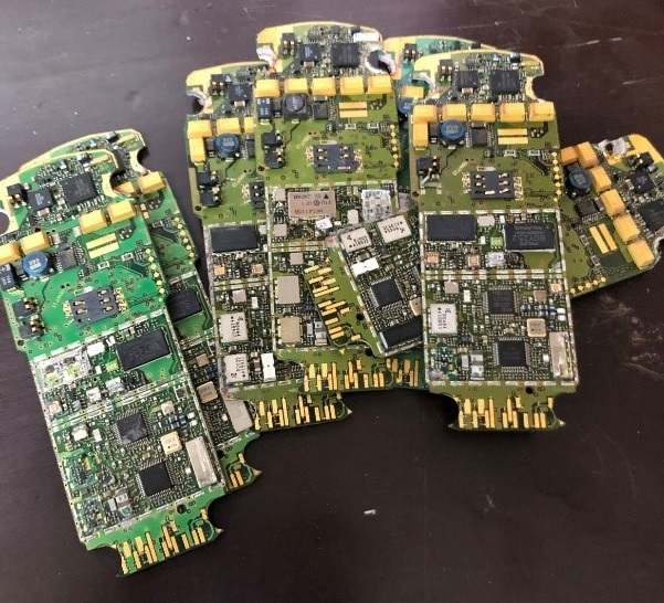 Output of machine 2: printed circuit boards extracted from a mobile phone.